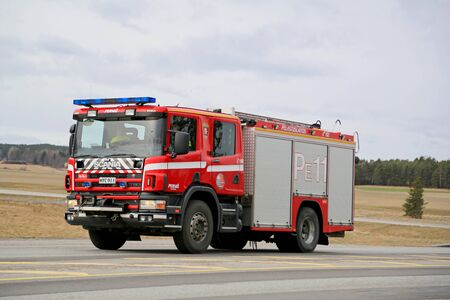SALO, FINLAND - MARCH 22, 2015: Scania Fire truck on highway 52. A traditional Scania waterrescue tender is typically built in a 4x2 or 4x4 configuration, with a 6 to 8 person CrewCab. Editorial
