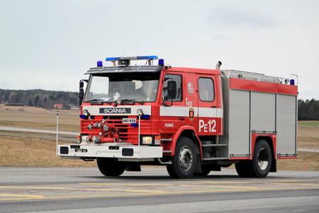SALO, FINLAND - MARCH 22, 2015: Classic Scania Fire truck rushes along highway 52. Scania fire trucks have been used by Finnish fire departments for over 100 years.
