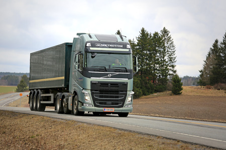 SALO, FINLAND - APRIL 3, 2015: Volvo FH 500 semi truck with Globetrotter cab on the road. The Globetrotter cab with interior height of max 193 cm was first introduced in 1979.