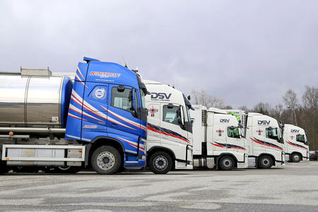 TURKU, FINLAND - APRIL 5, 2015: Five modern Volvo FH trucks parked on a yard. The process of developing a new truck starts many years before it is launched. Editorial