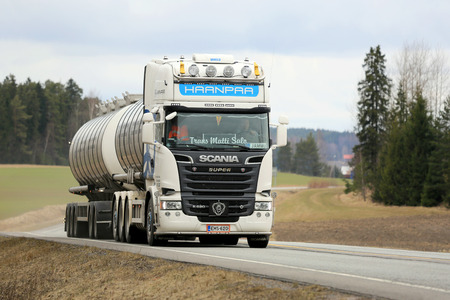 SALO, FINLAND - APRIL 3, 2015: White Scania R620 tank truck on the road. Scania publishes Sustainability Report 2014, which provides in-depth reporting on sustainability performance.