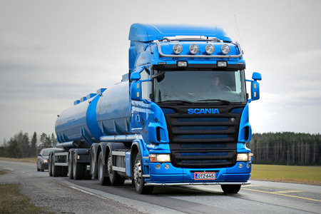 publishes: SALO, FINLAND - MARCH 22, 2015: Blue Scania R500 tank truck on the road. Scania publishes Sustainability Report 2014, which provides in-depth reporting on sustainability performance.