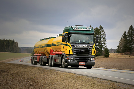 SALO, FINLAND - APRIL 3, 2015: Scania R500 tank truck on the road on cloudy weather. Study shows Scania supplies the most efficient alternative fuel technology.