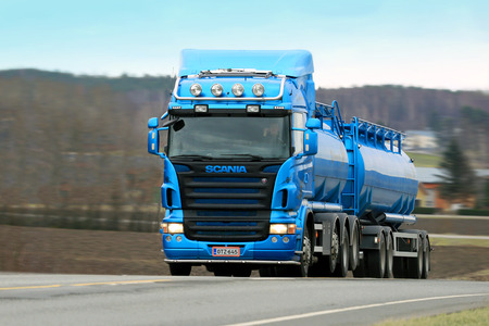highway 3: SALO, FINLAND - APRIL 3, 2015: Scania R500 tank truck on highway no. 52. Study shows Scania supplies the most efficient alternative fuel technology.