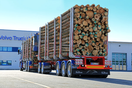 demanding: FORSSA, FINLAND - APRIL 11, 2015: Volvo FH16 700 logging combination vehicle. The Volvo FH16 is intended for the very heaviest and most demanding of transport operations.