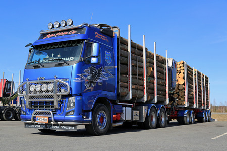demanding: FORSSA, FINLAND - APRIL 11, 2015: Volvo FH16 700 logging truck on a yard. The Volvo FH16 is intended for the very heaviest and most demanding of transport operations.
