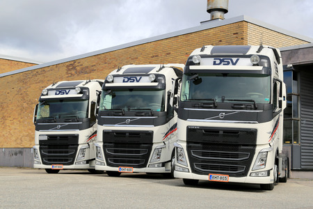 hauling tractor: TURKU, FINLAND - APRIL 19, 2015: Three Volvo FH truck tractors of DSV parked. The Danish transport company DSV has offices in more than 70 countries including Finland.