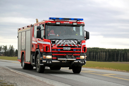 highway 6: SALO, FINLAND - MARCH 22, 2015: Scania Fire truck on highway 52. A traditional Scania water-rescue tender is typically built in a 4x2 or 4x4 configuration, with a 6 to 8 person CrewCab. Editorial