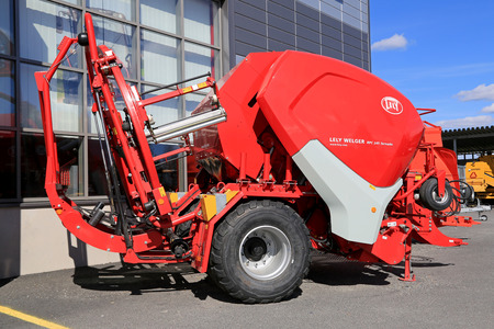 machine made: LOIMAA, FINLAND - APRIL 25, 2015: Lely Welger RPC 245 Tornado baler wrapper machine on a yard. The technology incorporated in this machine made it the first genuine variable baler wrapper combination.