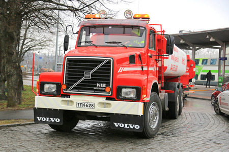 PUMPER: SALO, FINLAND - APRIL 12, 2015: Volvo N12 tank truck year 1988 used for industrial washing services. The water tank has capacity of 15000 litres.