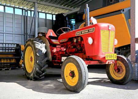 old tractor: LOIMAA, FINLAND - APRIL 25, 2015: The Classic David Brown 880 Implematic tractor was manufactured in England between 1961–1965.