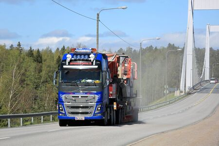 exceptional: PARAINEN, FINLAND - MAY 14, 2015: Volvo FH16 hauls exceptional load. In Finland the authorized dimensions and total weights are partly bigger than in the rest of Europe. Editorial
