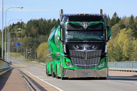 internationally: PARAINEN, FINLAND – MAY 17, 2015: The internationally famed show truck Mercedes-Benz Actros 2551 Highway Hero owned by Kuljetus Auvinen Oy hauls cement by day.