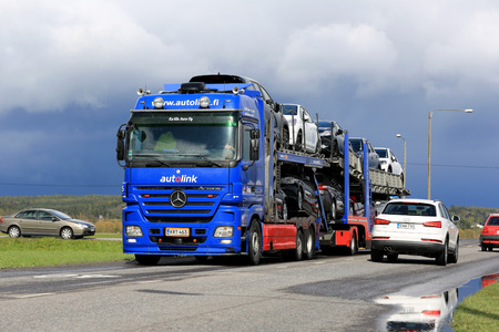 car carrier: SALO, FINLAND - MAY 15, 2015: Mercedes-Benz Actros car carrier hauls a load of new cars. The Finnish automotive industry estimates that a total of 109,000 new passenger cars will be sold in Finland in 2015.