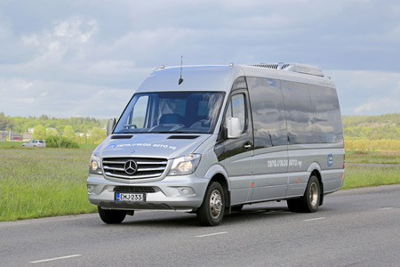 mercedes: SALO, FINLAND - JUNE 7, 2015: Mercedes-Benz Sprinter minibus transports passengers. The MB Sprinter has a seating capacity from 13 to 19 passengers.