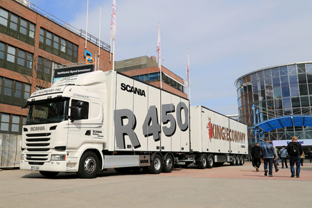 fuel economy: HELSINKI, FINLAND - JUNE 11, 2015:  Scania Finland presents Scania R450 combination vehicle for fuel economy testing at Logistics Transport 2015.