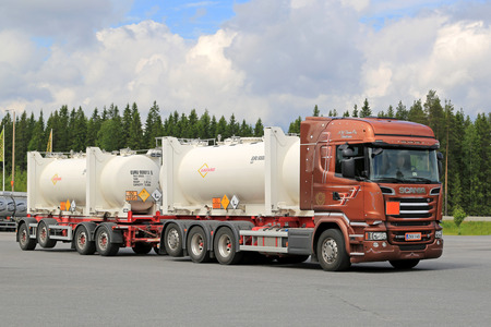 HIRVASKANGAS, FINLAND - JUNE 20, 2015: Scania R520 Euro 6 tank truck hauls flammable goods. The ADR label 50-1495 stands for sodium chlorate.