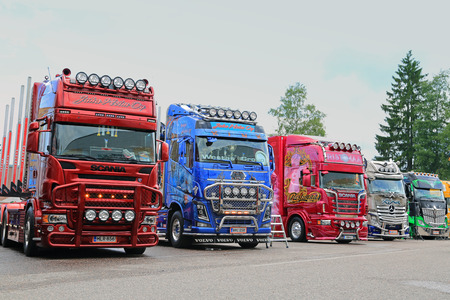 line up: PORVOO, FINLAND - JUNE 27, 2015: Line up of Scania, Volvo and Mercedes-Benz show trucks on display at Riverside Truck Meeting 2015.