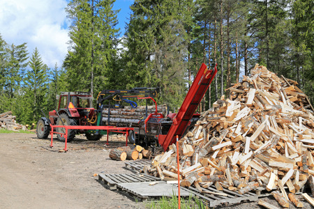 engine powered: SALO, FINLAND - MAY 31, 2015: Palax firewood processor at the edge of woodland. The machine is available powered eg. by tractor.