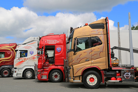 lineup: HAMEENLINNA, FINLAND - JULY 11, 2015: Lineup of colorful Volvo and Scania Trucks at Tawastia Truck Weekend 2015. Editorial
