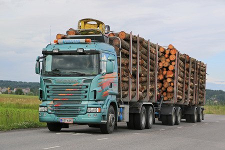 commercial tree service: SALO, FINLAND - JULY 10, 2015: Scania R500 logging truck with log load. 2015 marks a substantial leap in forest industry investments in Finland.