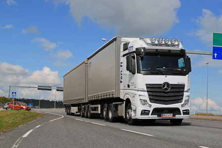 salo: SALO, FINLAND - JULY 17, 2015: White Mercedes-Benz Actros 2551 truck-trailer in traffic. Mercedes-Benz Actros wins The Green Truck 2015 Award.