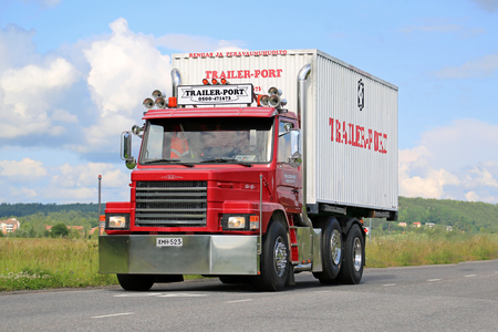 litre: SALO, FINLAND - JULY 17, 2015: Red, tuned Scania T92 on the road. The Swedish truck manufacturer Scania introduced the 2-series in 1980, and the 9 litre 92 was added in 1984.
