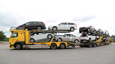 TURKU, FINLAND - JULY 12, 2015: Volvo FM car carrier hauls new cars. A scrapping scheme for old vehicles will be carried out in Finland between 1 July and 31 December 2015.
