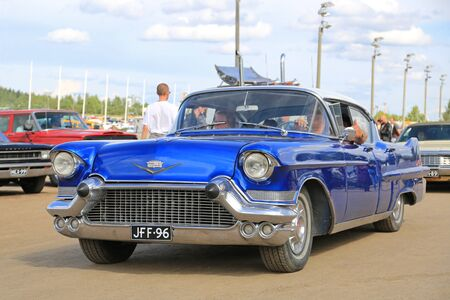 of yesteryear: FORSSA, FINLAND - AUGUST 2, 2015: Classic blue Cadillac 4D Sedan Series 62 at Pick-Nick Car Show in Forssa, Finland.