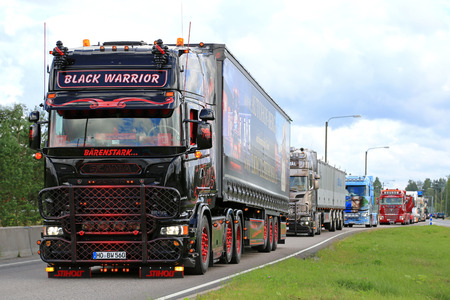 convoy: JALASJARVI, FINLAND - AUGUST 6, 2015: Scania R620 Black Warrior from Germany takes part in the truck convoy to Power Truck Show 2015 in Alaharma, Finland.