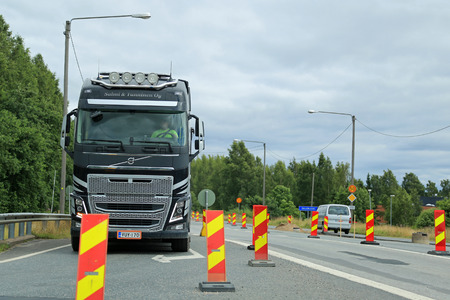 road works: SALO, FINLAND - JULY 31, 2015: Volvo FH truck driving through road works in Salo, Finland. Road works slow down traffic particularly in South of Finland during the summer months of 2015.