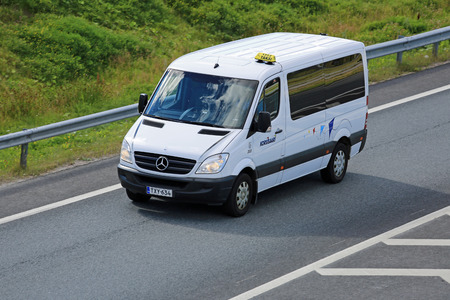 mini bus: SALO, FINLAND - AUGUST14, 2015: Mercedes-Benz Sprinter minibus on the Motorway. The first generation of Sprinter was launched in Europe in 1995.