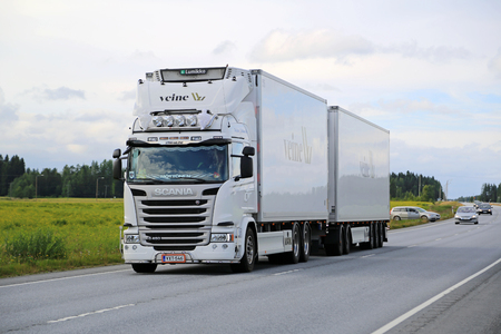 LUOPAJARVI, FINLAND - AUGUST 6, 2015: Scania G450 temperature controlled truck on the road. Early introduction of the Euro 6 range contributed to Scania's record high market share in Europe in Q2 of 2015.