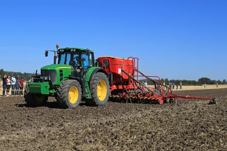 salo: SALO, FINLAND - AUGUST 22, 2015: Unnamed farmer demonstrates John Deere 7430 tractor and Vaderstad Spirit 600C Seed Drill at Puontin Peltopaivat Agricultural Harvesting and Cultivating Show.