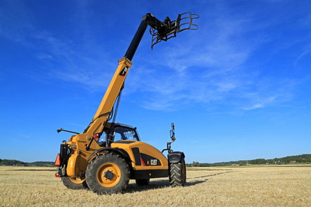 handler: SALO, FINLAND - AUGUST 21, 2015: Cat TH407C Telescopic handler on display at the day of setting up Puontin Peltopaivat Agricultural Harvesting and Cultivating Show.