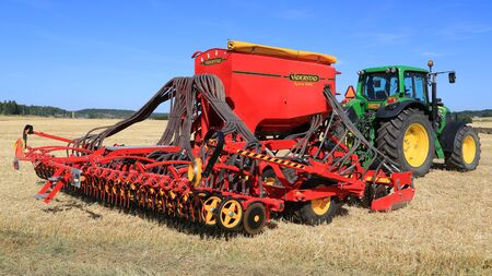 salo: SALO, FINLAND - AUGUST 21, 2015: Vaderstad Spirit 600C Seed Drill and John Deere 7340 tractor on field at the set up of Puontin Peltopaivat Agricultural Harvesting and Cultivating Show.