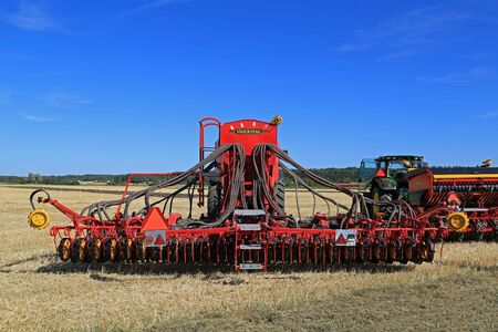 john deere: SALO, FINLAND - AUGUST 21, 2015: Vaderstad Spirit 600C Seed Drill and John Deere tractor on field at the set up of Puontin Peltopaivat Agricultural Harvesting and Cultivating Show. Editorial