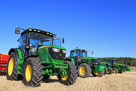 salo: SALO, FINLAND - AUGUST 22, 2015: Line up of four John Deere agricultural tractors, 6115R and 7340 on the left, at Puontin Peltopaivat Agricultural Harvesting and Cultivating Show. Editorial