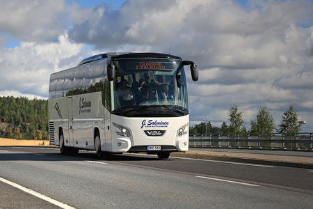 omnibus: SALO, FINLAND - AUGUST 29, 2015: White VDL Futura coach bus on the road in Salo. The New Futura was introduced in 2010 and won the International Coach of the Year award in 2012.
