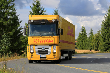 magnum: SALO, FINLAND - AUGUST 30, 2015: Yellow Renaut Magnum semi truck on the road. Renault Magnum was manufactured in 1990-2013 and it received the International Truck of the Year award  in 1991.