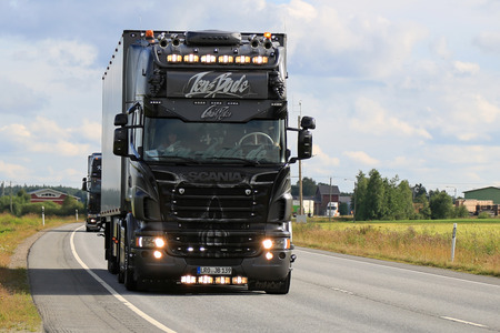 bode: LUOPAJARVI, FINLAND - AUGUST 6, 2015: Jens Bode Scania R 730 Ghost Rider takes part in the truck convoy to Power Truck Show 2015 in Alaharma, Finland. Editorial