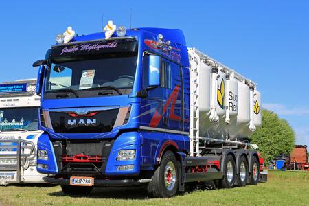 animal feed: ALAHARMA, FINLAND - AUGUST 7, 2015: New MAN TGX 35.480 8X4 year 2015 for animal feed or bulk transport on display in Power Truck Show 2015. Editorial