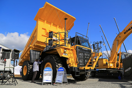 unnamed: HYVINKAA, FINLAND - SEPTEMBER 11, 2015: Unnamed men demonstrating Komatsu HD605 Rigid dump truck for mining at MAXPO 2015.