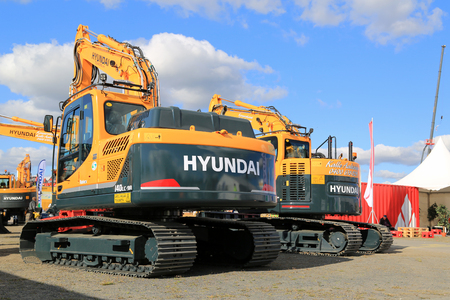 tonne: HYVINKAA, FINLAND - SEPTEMBER 11, 2015: Huyndai 140LC 14 Tonne crawler excavator among Huyndai construction machinery at MAXPO 2015.