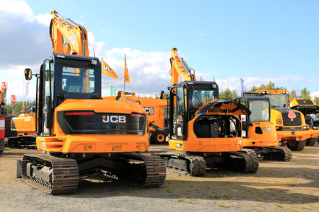 compact track loader: HYVINKAA, FINLAND - SEPTEMBER 11, 2015: JCB crawler excavators on display at MAXPO 2015.