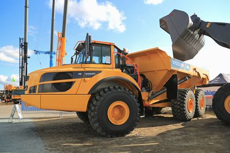 dumper: HYVINKAA, FINLAND - SEPTEMBER 11, 2015: Volvo A40G Articulated hauler or dumper truck on display at MAXPO 2015.
