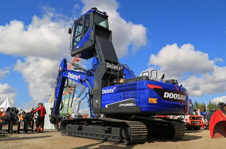 crawler: HYVINKAA, FINLAND - SEPTEMBER 11, 2015: Doosan DX255LC hydraulic crawler excavator of Delete Oy on display at MAXPO 2015.