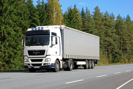 indices: FORSSA, FINLAND - SEPTEMBER 19, 2015: MAN TGX 18.440 semi truck on the road. MAN SE is again listed in Dow Jones Sustainability World and Europe Indices.
