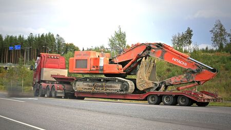 tonnes: FORSSA, FINLAND - SEPTEMBER 19, 2015: Volvo FH16 hauls a Hitachi Zaxis 470 LCH Excavator. The  operating weight of 470LHC is 48,1 tonnes. Editorial