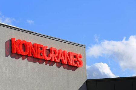 company name: HYVINKAA, FINLAND - SEPTEMBER 26, 2015: Konecranes signage at the Konecranes Corporation headquarters in Hyvinkaa. Konecranes and Terex are to form leading global lifting and material handling solutions company.